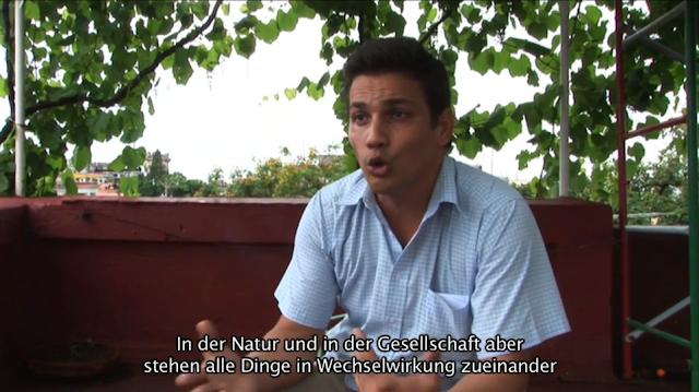 Interviewbild, Zitat: In Natur und Gesellschaft stehen alle Dinge in Wechselwirkungen zueinander.