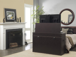 The leather wrapped TV lift cabinet fits at the end of a bed and hides the TV when it's not in use.