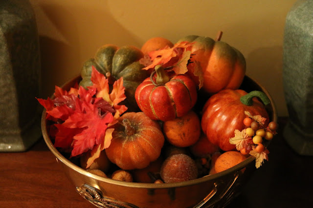 brass bowl with pumpkins
