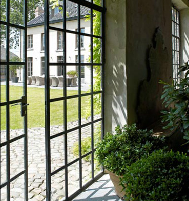 Iron and glass doors, Garnier orangerie via the Garnier (be) website as seen on linenandlavender.net