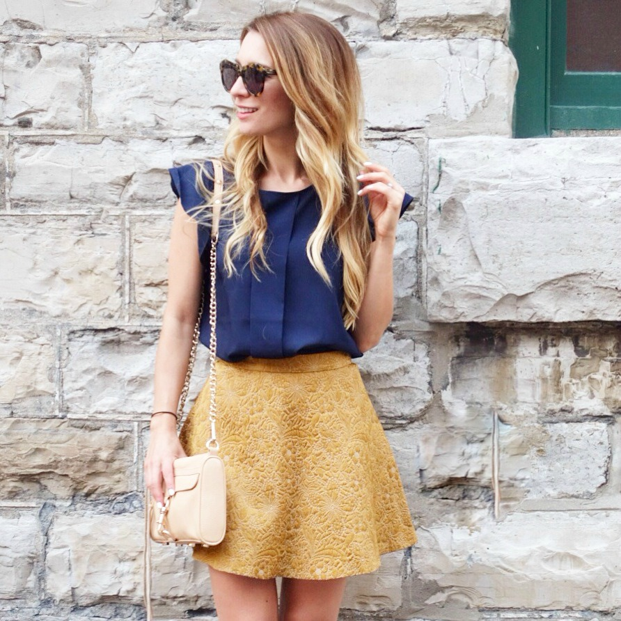gold skirt navy top outfit