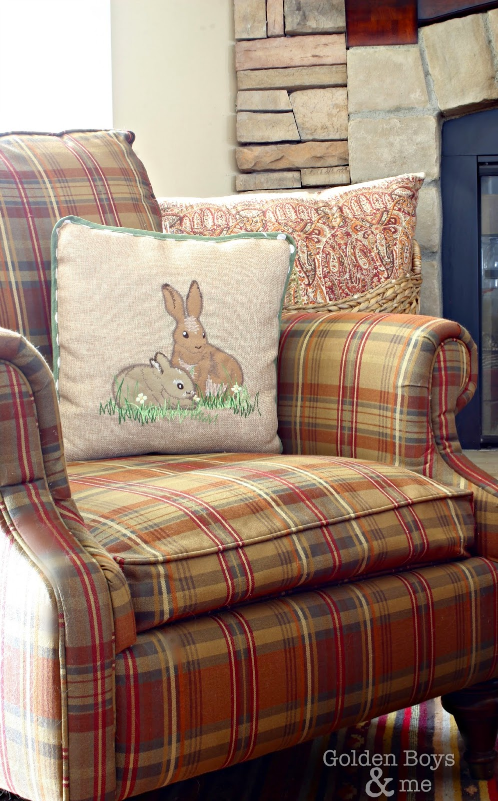 Bunny pillow on plaid chair in Spring family room-www.goldenboysandme.com
