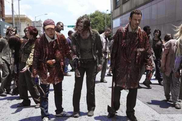 Glenn and Rick blending and pretending as walkers.