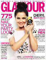 Cheryl Cole holding a camera on a cover of glamour magazine december 2012 issue