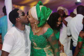 Comedian AY and his wife Mable kissing