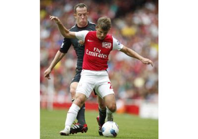 Liverpool's Charlie Adam and Arsenal's Andrey Arshavin in action