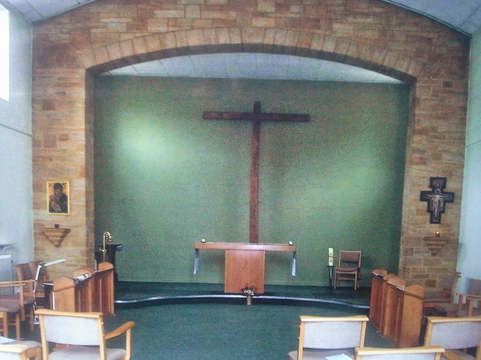 The Chapel at Compton Durville facing the altar with large wall mounted Franciscan Tau Cross
