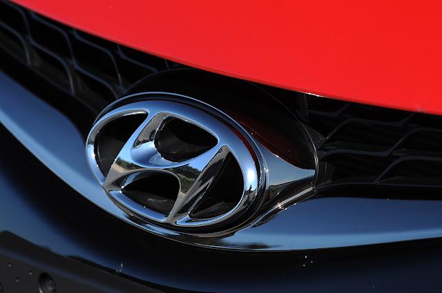 значек Hyundai Elantra Coupe 2013