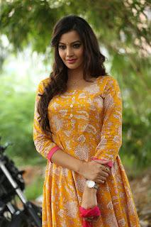 Diksha Panthi n a Tight Yellow Anarkali Suit and Red Dupatta