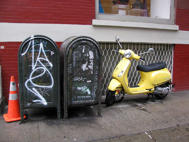 A-Yellow-Scooter-and-Mailboxes-in-Soho-New-York