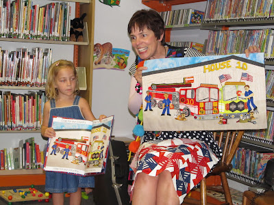 "photo of: Debbie Clement at the Library Sharing, ""Red, White and Blue"" picture book in response to 9-11"
