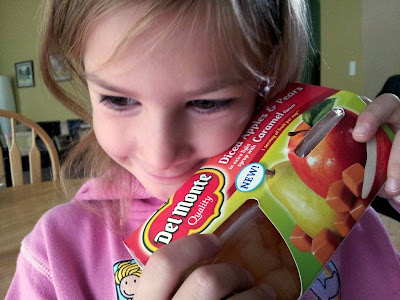 Little Miss loving on the Del Monte Fruit Cups
