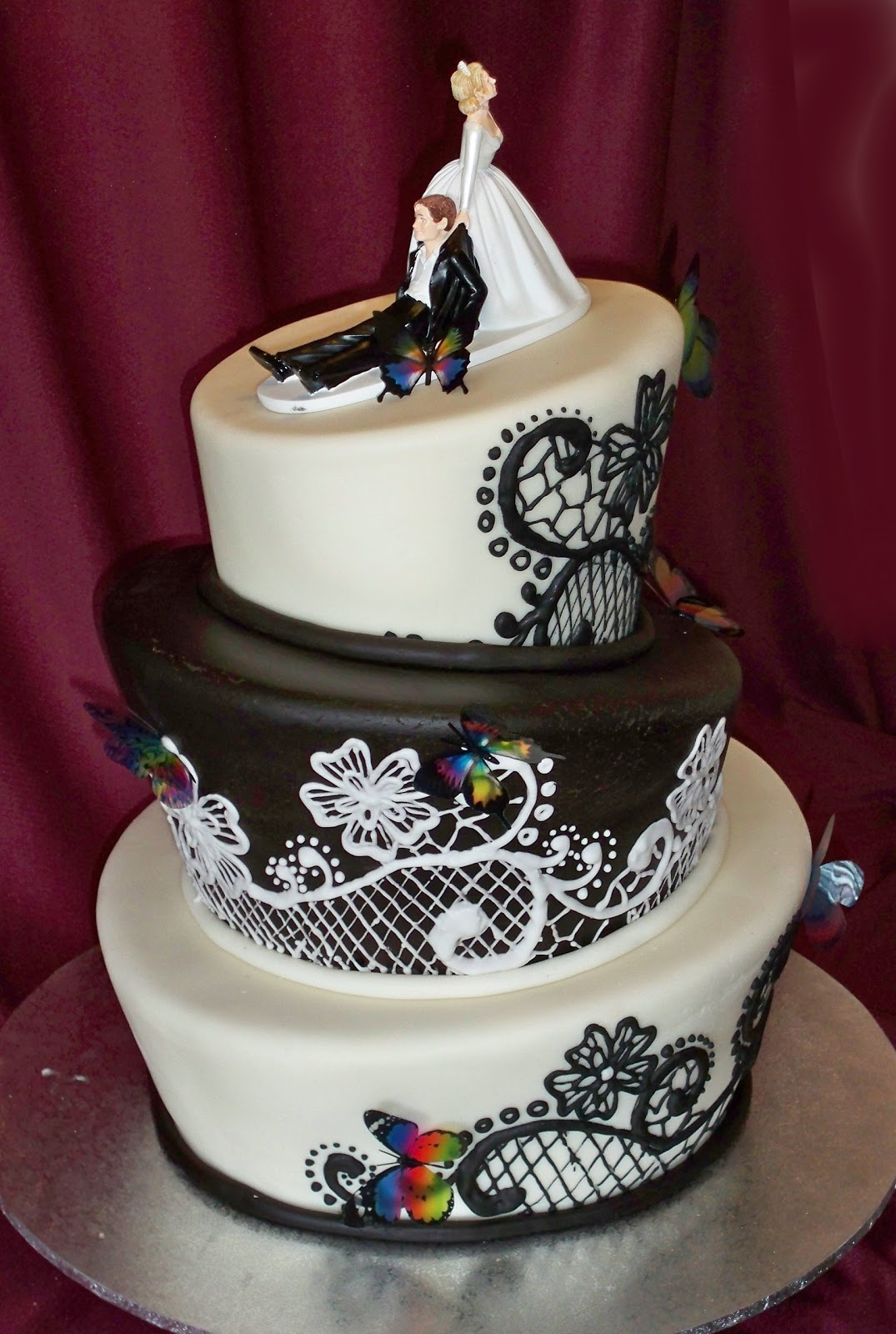 elegant black and white topsy turvy wedding cake with