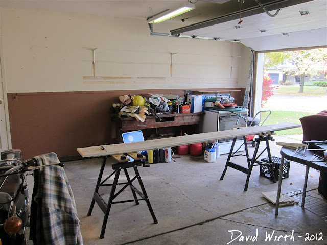 construction in the garage, saw horse, cut shelf to size