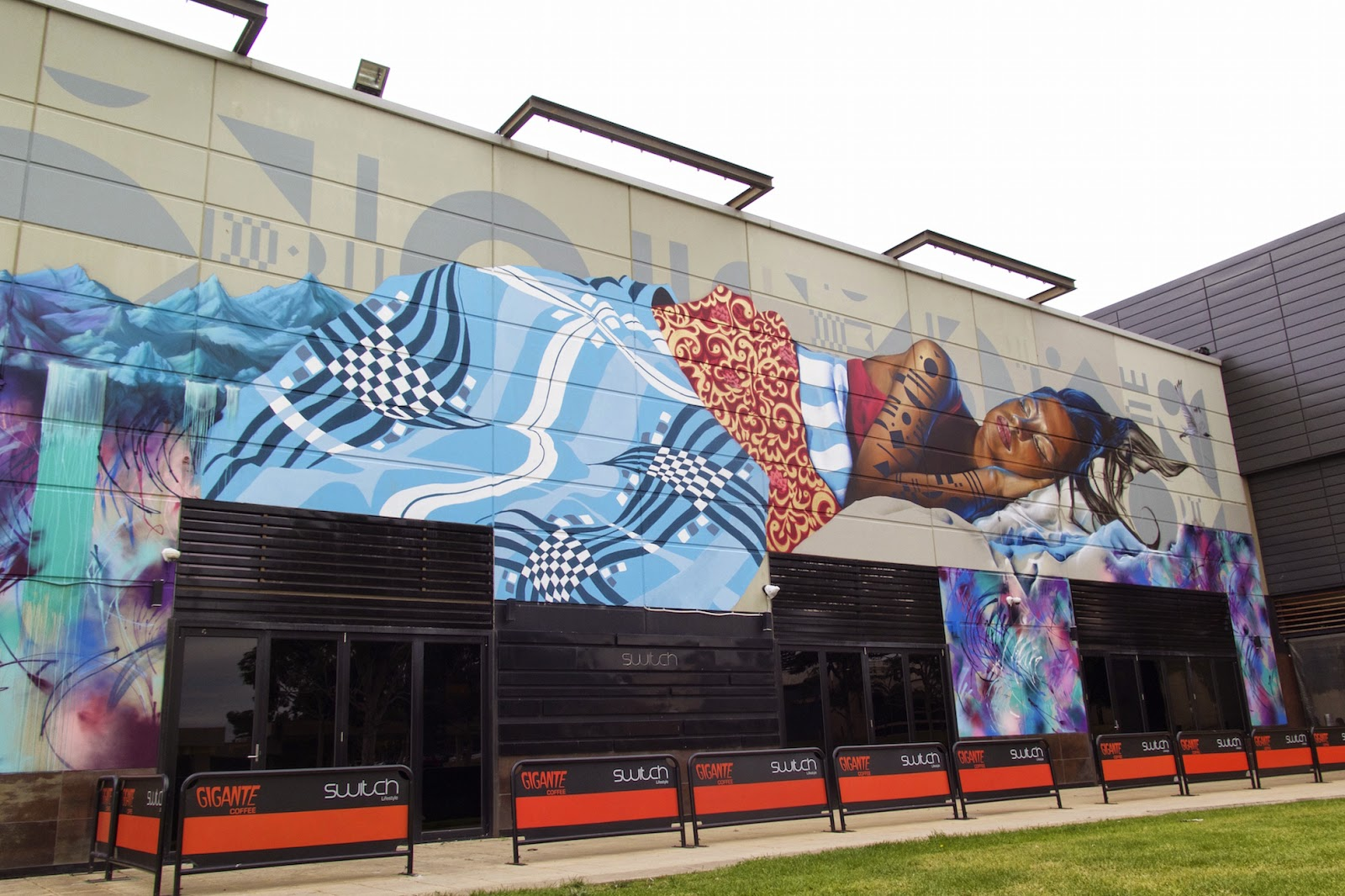 AWOL Crew recently spent four days painting the entire side of a large building at Fountain Gate in Melbourne's outer suburbs. The crew consists of Adnate, Slicer, Lucy Lucy, Deams and Itch all of which have their own diverse painting styles making their large scale murals unique.