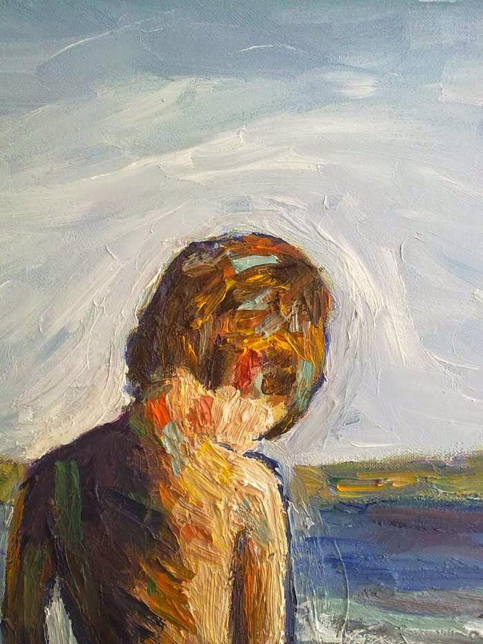niño en la playa detalle de la cabeza