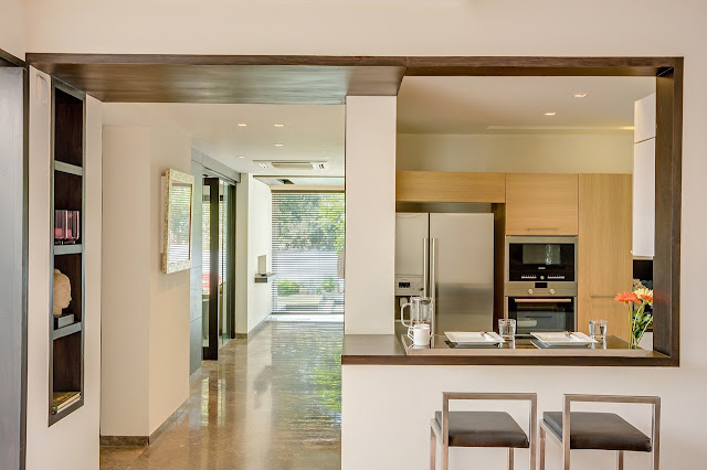Picture of hallway and modern kitchen with corner bar