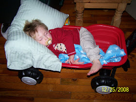 Taban asleep in wagon