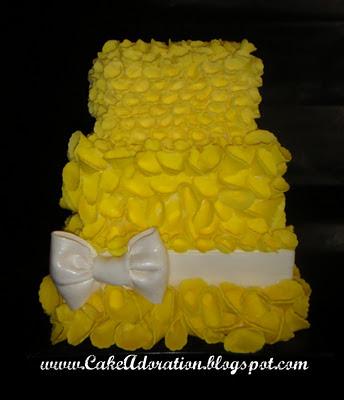 This stunning Yellow Black and White wedding cake has hundreds of