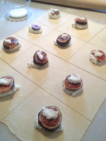 Image shows the fig and chevre filling atop the dough, before the pastries are sealed
