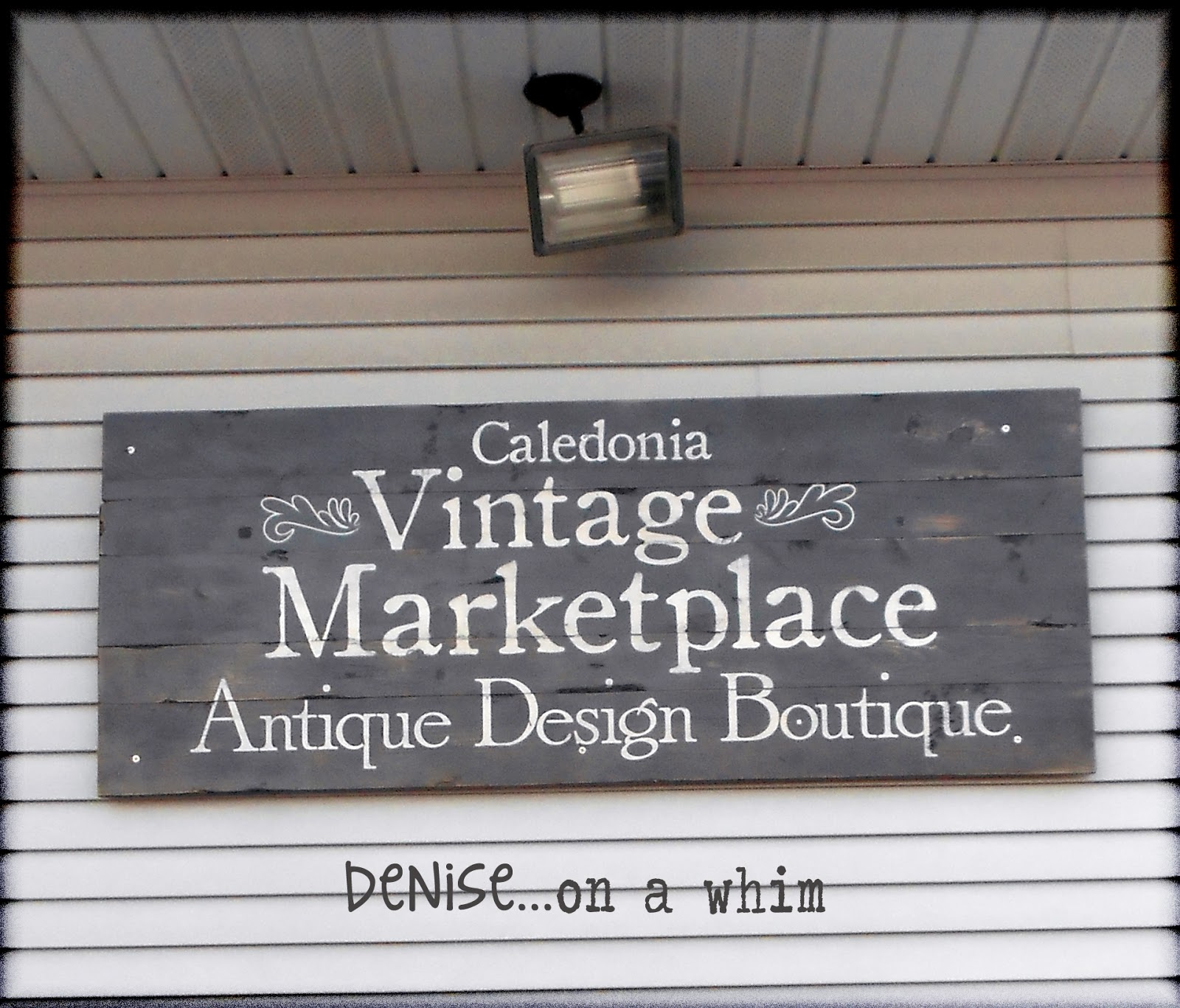 Painted Wood Store Entrance Sign via http://deniseonawhim.blogspot.com