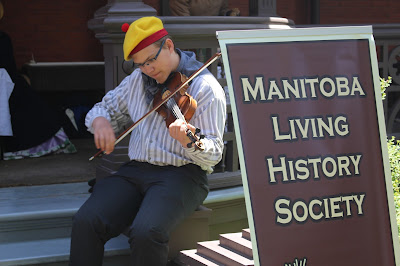 A member of the Manitoba Living History Society plays a violin at Dalnavert Museum.