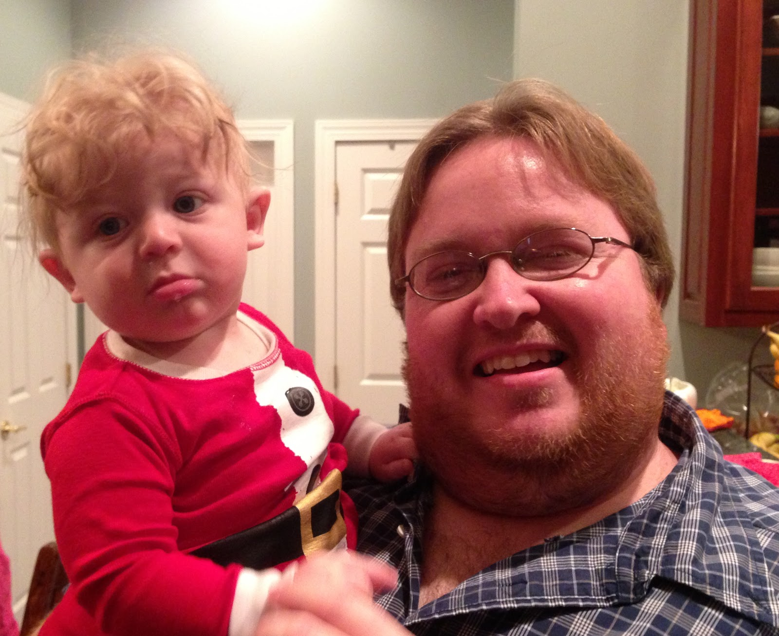 Wonderful image of Jeremy and the cutest little Santa Mason!!! with #C20935 color and 1600x1306 pixels