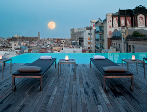 Exotic swimming pool designs with beautiful city view for Swimming pool construction design