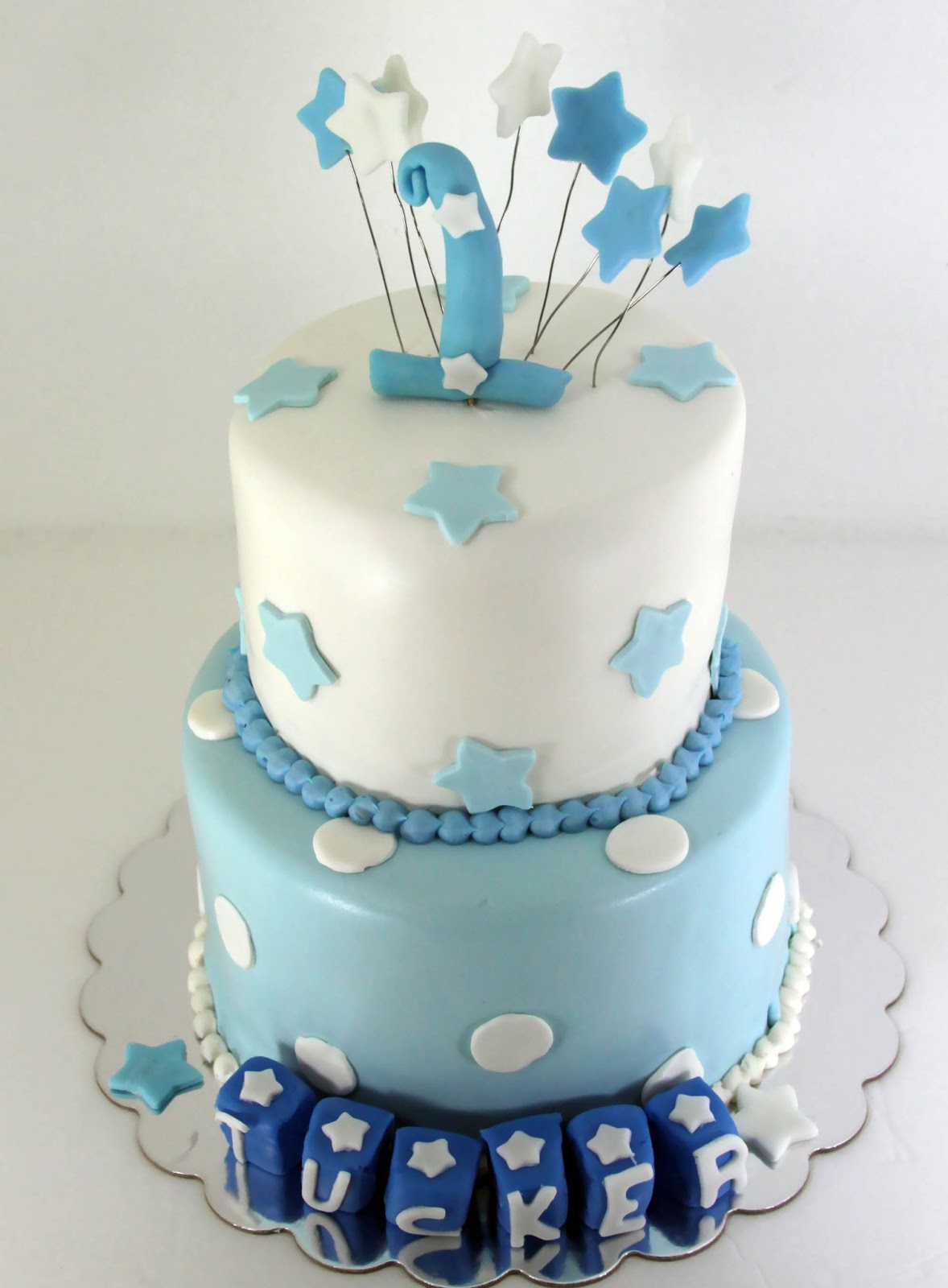 Tastefully done baby boy blue 1st birthday cake for Baby boy cake decoration