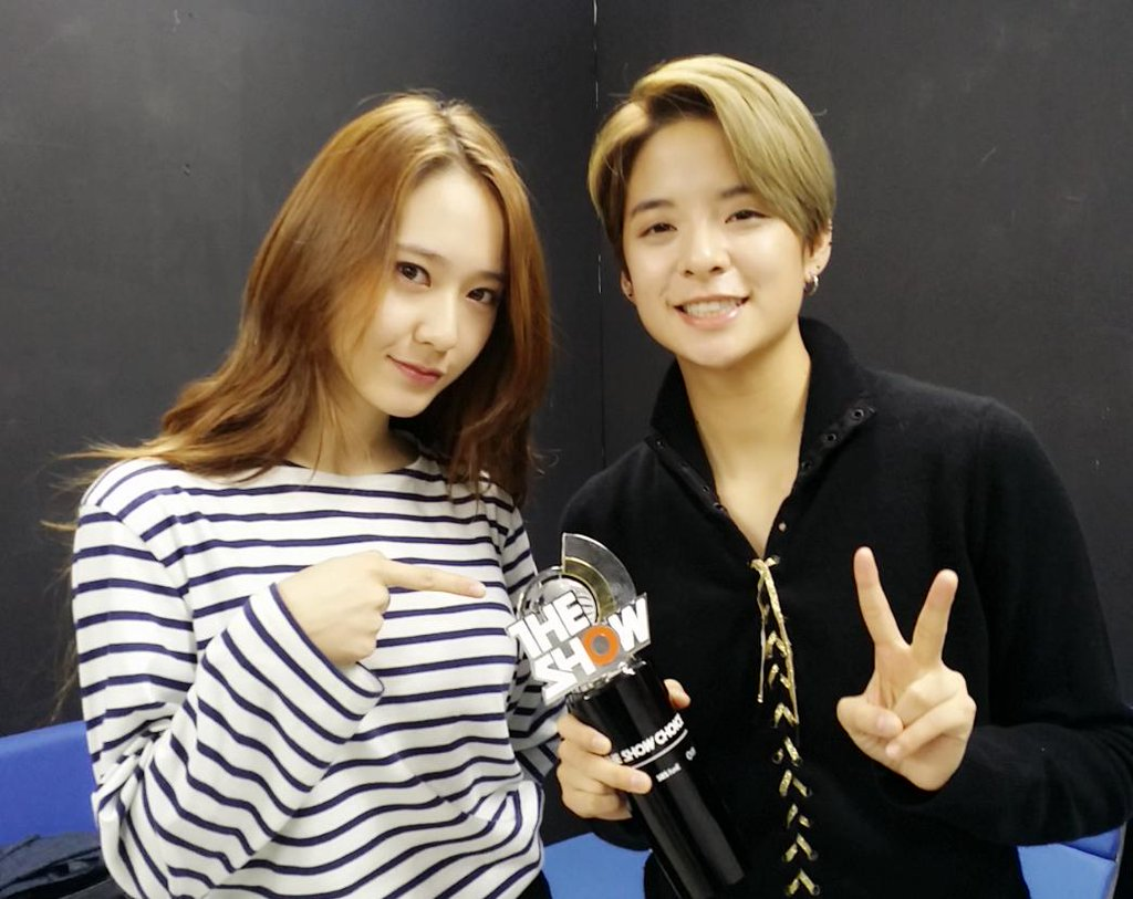 fx krystal and amber posed with their trophy from the