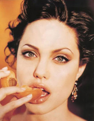 angelina jolie eating an apricot