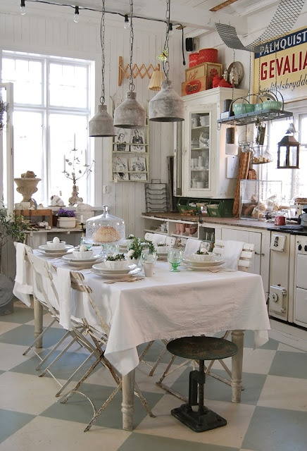 Vintage cabinets and industrial lighting and signage combines country styles in this kitchen