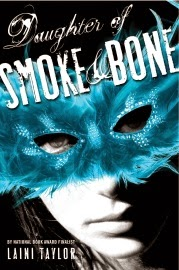 Cover art for Daughter of Smoke and Bone by Laini Taylor, featuring a pale-skinned young woman wearing a blue feathered mask.