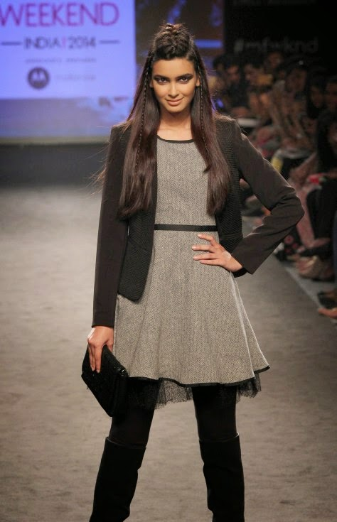 Diana Penty walking on the ramp for Elle