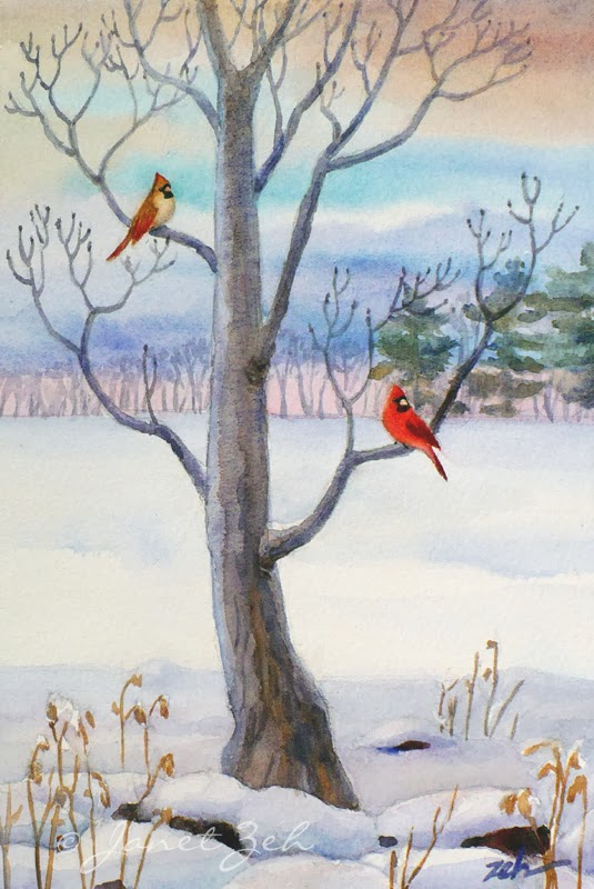 Two cardinals on a small tree in the snow