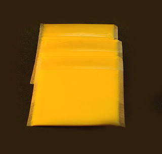 Three Kraft processed American cheese slices