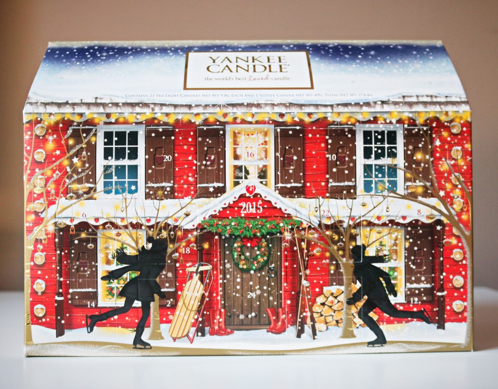 The mid-range Yankee Candle calendar offering is the Fold Out Advent, which reveals a beautiful Christmas scene within the box and gives you a mix of 12 Votives and 12 Tea Lights each day, as well.