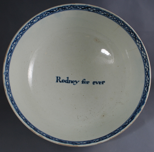 white porcelain bowl painted with a blue border and the small simple phrase 'Rodney for ever'