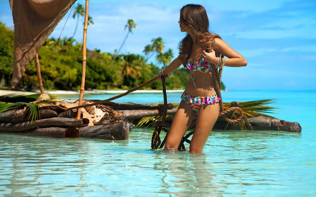 Clara Alonso Tugging a Wooden Boat