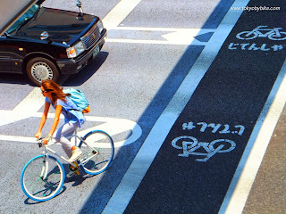 woman bicycle lane tokyo Japan