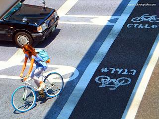 woman bicycle lane tokyo Japan
