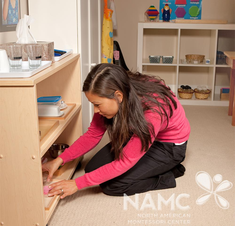 NAMC montessori teacher checking the shelves and materials montessori classroom environment