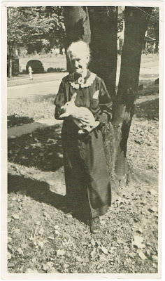 Cassie Davis standing outside her home in Erwin TN holding a white rabbit