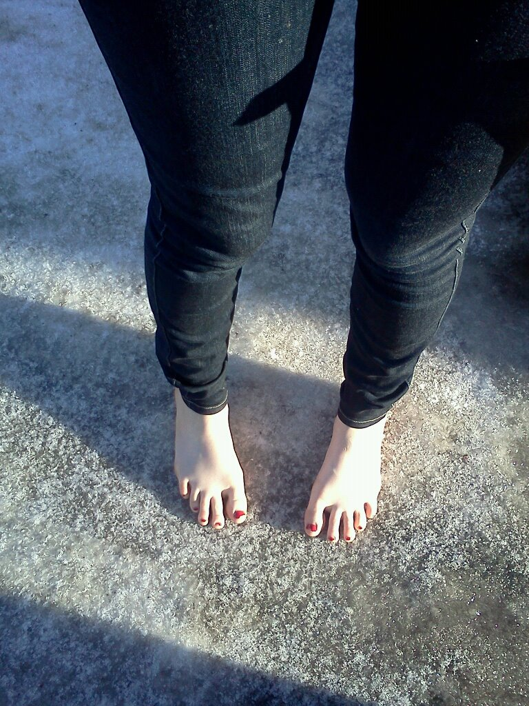 Girl Barefoot On-Ice