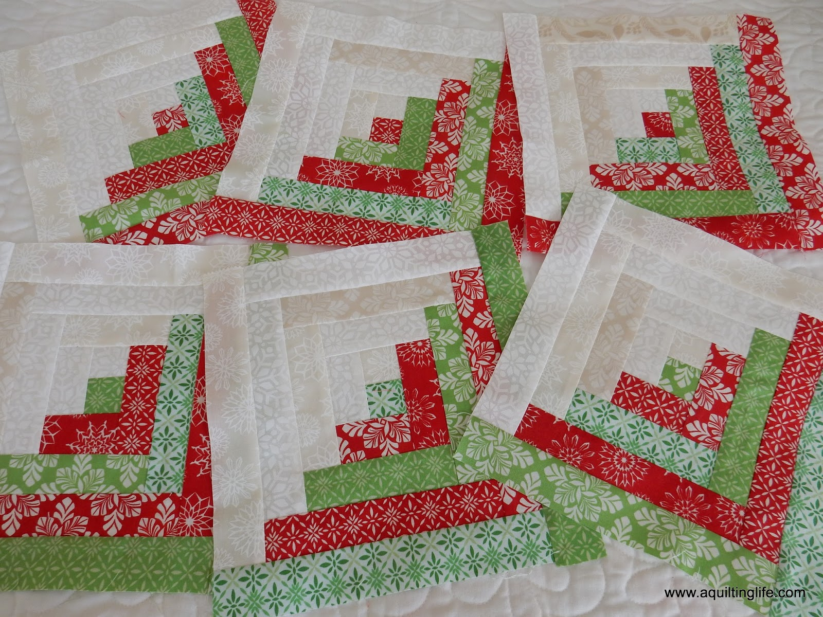 Log cabin christmas table topper tutorial a quilting for Log cabin project