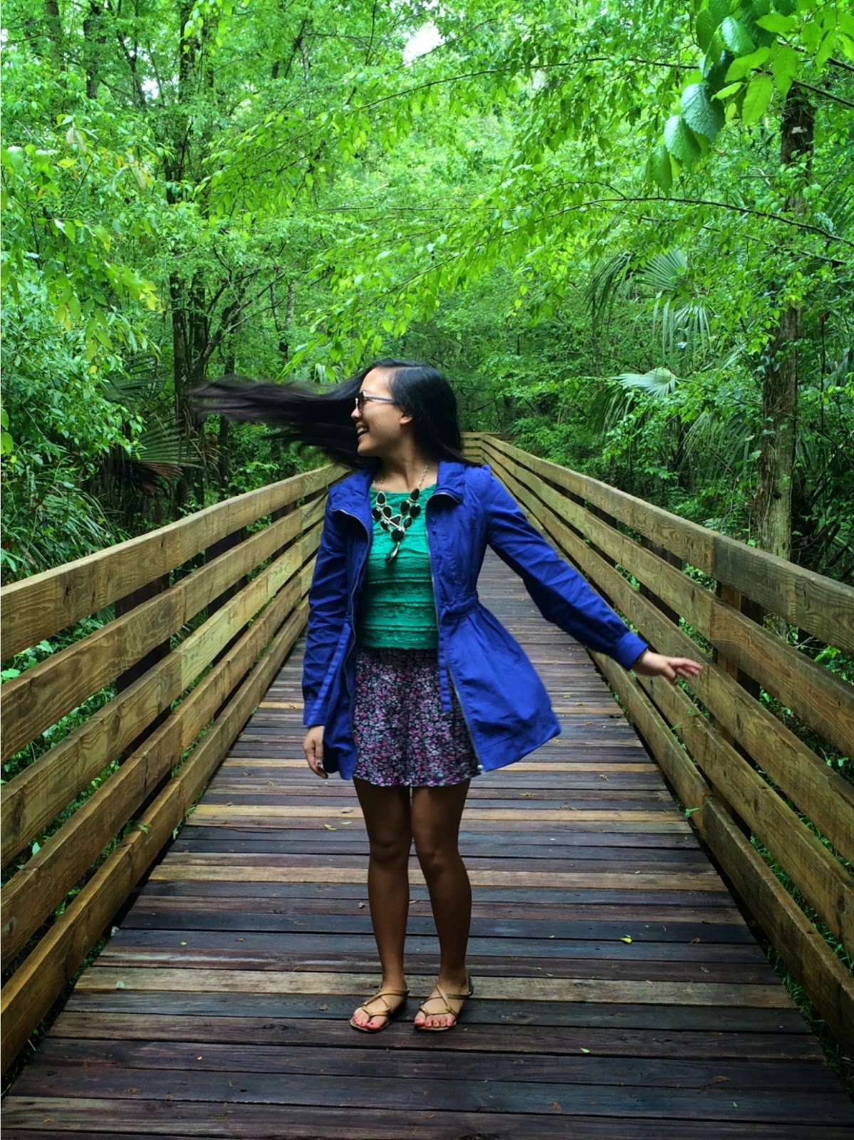 spring outfit, rainy day outfit, cobalt blue jacket, floral ruffle shorts