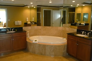 Beautiful Master Bathroom suites with granite & tile