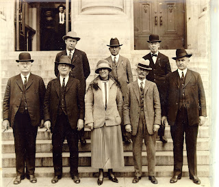 The first woman police officer in Houston, Eva Jane, stand among her colleagues.