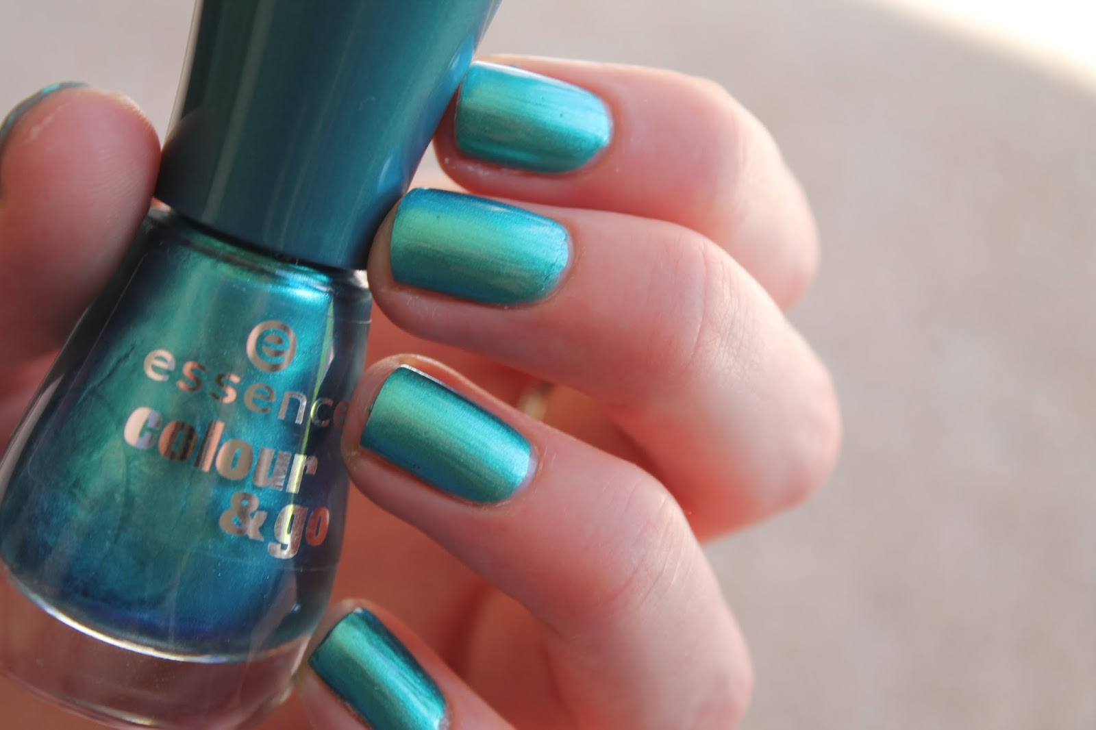essence colour and go nail polish - 172 splash swatch