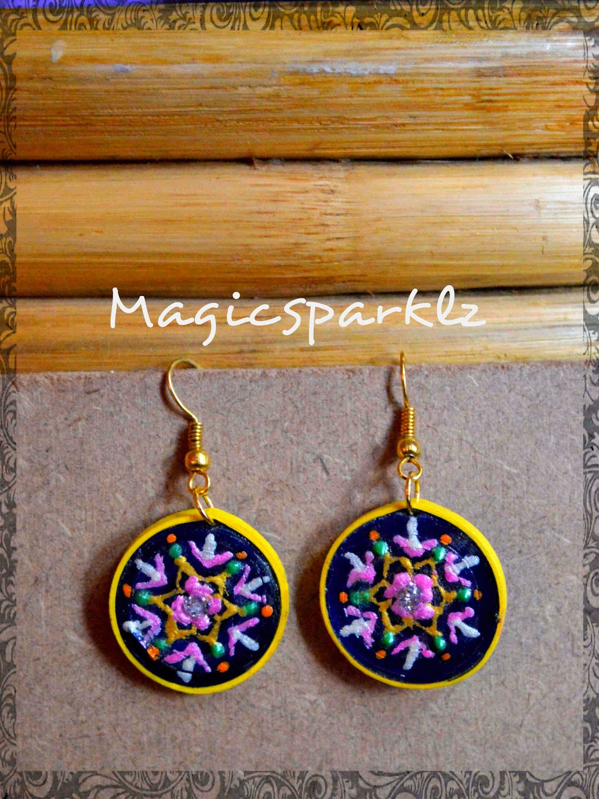 Elegantly pained quilled earrings